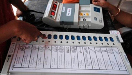Polling officers check electric voting machines to be used in the first phase of elections, in Hyderabad, India, Wednesday, April 15, 2009. Thousands of troops fanned out across parts of India on Wednesday, a day ahead of elections to determine who will lead the country as the global economic slump threatens to undo two decades of growth. (AP Photo/Mahesh Kumar A.)