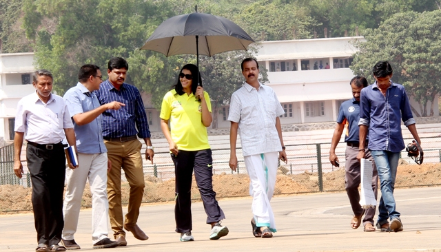 Anju Boby George assessing the progress of the synthetic track worksat Calicut University stadium 2